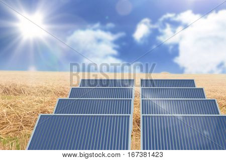 Digitally generated image of three dimensional of solar equipment against sunny brown landscape