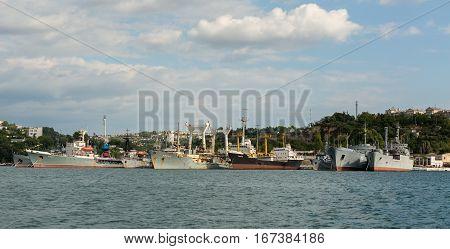 Sevastopol, Russia - June 09, 2016: Russian and Soviet Black Sea Fleet warships, standing in quay of Sevastopol bay, Crimea