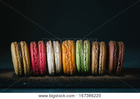 Close-up of colorful macaroons. Stack of sweet macaroons, green, pink and orange color