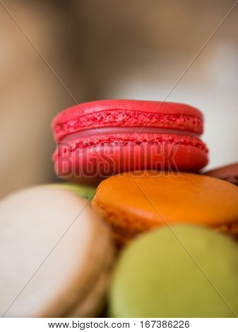 Colorful macaroons, close-up view. Pink strawberry macaroon