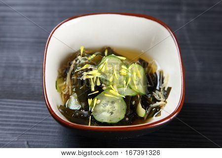 studio shot of cucumber and seaweed salad