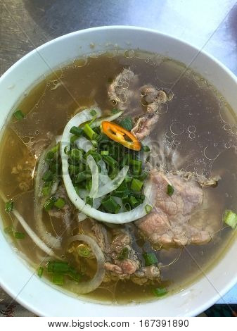 Big closup bowl of Vietnamese beef noodle soup, Pho Bo. Mobile Photo