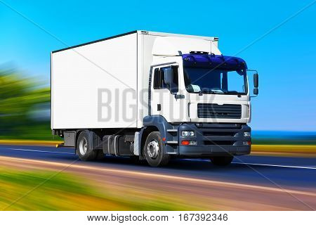 White delivery truck or container auto car trailer on road way or highway with high speed motion blur effect