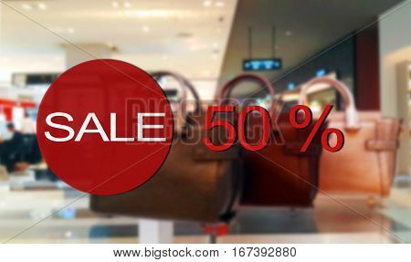 red sale sign on store showcases wihdow
