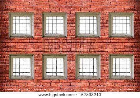 windows with bars of iron on red old brick wall with clipping path