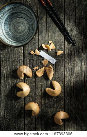 The fortune cookies on old wooden table. Top view.