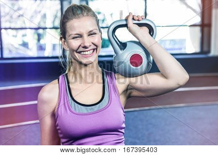 Portrait of woman holding kettlebell crossfit