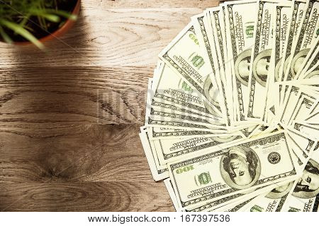 Photo dollars on wooden background on the left there is a place for advertising text