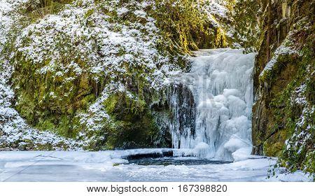 Forest waterfall in Baden-Baden in winter. Europe, Germany