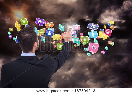Businessman in suit pointing these fingers against gloomy sky 3d