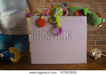 Young girl with used toys in secondhand shop