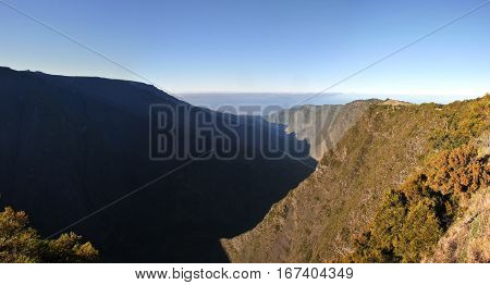 Silaos Cirque of Reunion Island Wide View with blue sky in the morning light