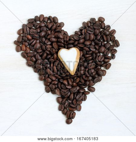Two heart symbol made from coffee beans and gingerbread top view / are different and similar simultaneously