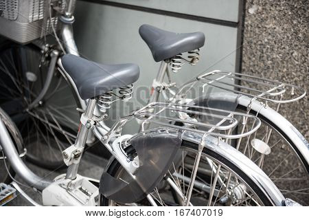 Couple bikes parked outside a building is seen in this image.