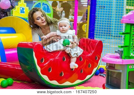 mother and child play in the children's room