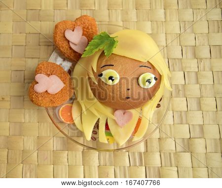 Sandwich in the form of the girl's heads. Sandwich is made of a roll and cheese. Creative food for darlings and children.