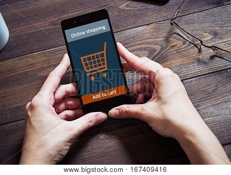 A woman is shopping at the online store. Shopping cart icon. ecommerce