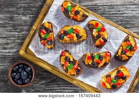 Crostini With Pieces Of Fish Stewed In Tomato Sauce