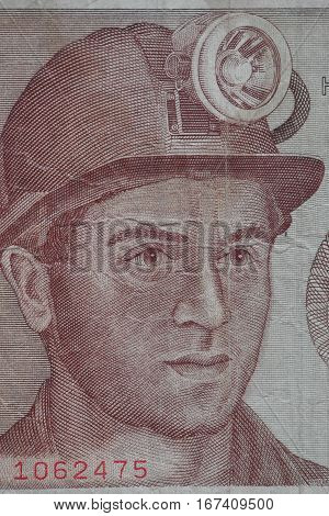 Miner in a helmet with a lantern portrait on a banknote