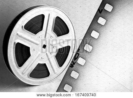 Old motion picture film reel with film strip.
