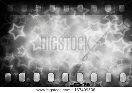 Grunge scratched grayl film strip background with stars