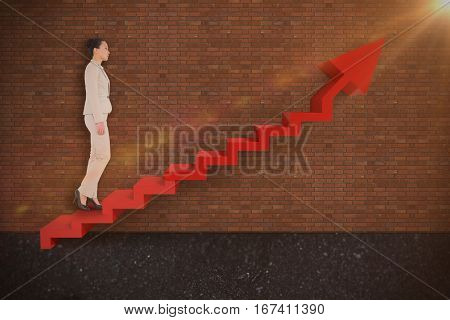 Unsmiling asian businesswoman walking against brick wall 3d