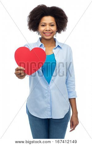 people, love, valentines day and health concept - happy african american young woman with red heart shape over white
