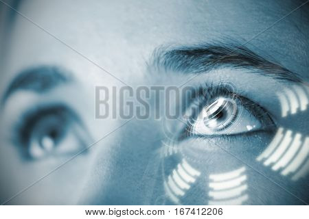 Digital composite of volume knob against close up of woman with brown eyes