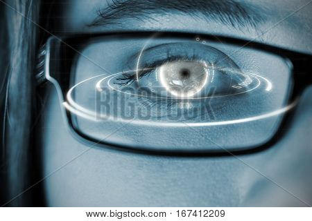 Digital image of globe with light trail against eye of a woman wearing spectacles