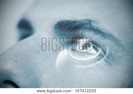 Digital interface of volume dial against cropped image of man with gray eyes