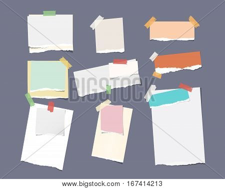 Pieces of different size ruled colorful bright note, notebook, copybook paper sheets stuck with sticky tape on dark gray background.