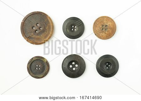 Many old Round buttons with cracks on over white