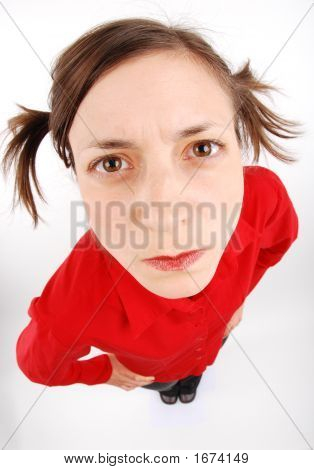 Angry woman looking up in red blouse with arms akimbo poster