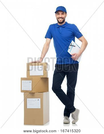 delivery service, mail, logistics, people and shipping concept - happy man with parcel boxes and clipboard