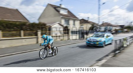 Conflans-Sainte-HonorineFrance-March 62016: The Kazakh cyclist Daniil Fominykh of Astana Team riding during the prologue stage of Paris-Nice 2016.