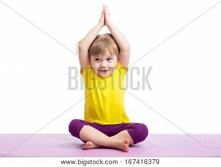 Kid doing fitness exercises over white background