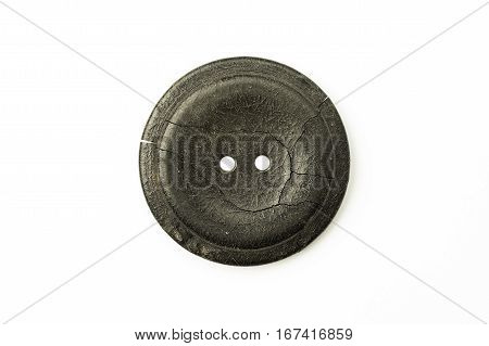 The old Round button with cracks on over white