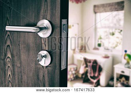 Brown door with metal doorknob and lock against bedroom