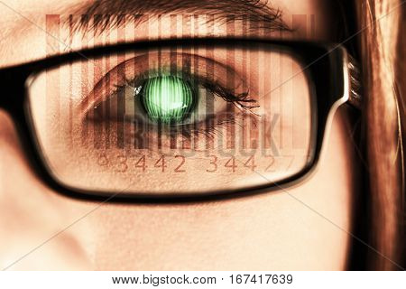 Composite image of Bar code against eye of a woman wearing spectacles