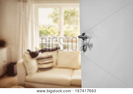 Closeup of white door with metal doorknob and lock against sitting room