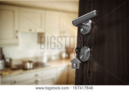Low angle view of brown door with house key against kitchen interior