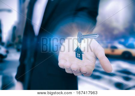 High angle view of silver metallic key and home keychain against new york street