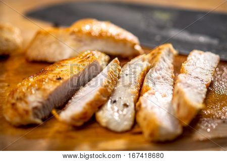 Grilled chicken breast cut into strips .