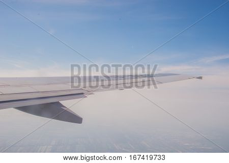 blue sky View above the Clouds from air plane