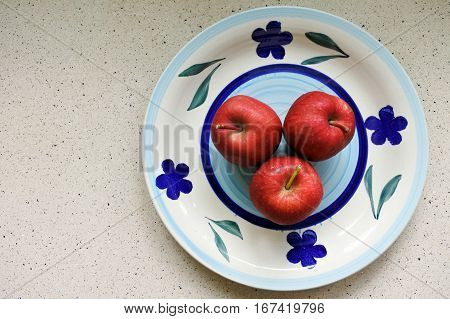 Flat Lay View Of Three Red Apples On A Plate
