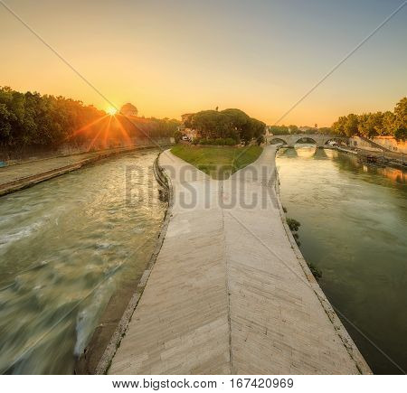 Summer view of Tiber Island in Rome at sunrise, Italy, Europe.
