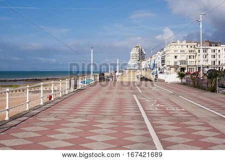 Hastings promenade East Sussex England view to the west of the pier selective focus on the nearest palm tree on the right