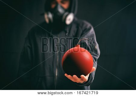 Hooded Man Holding A Red Bomb