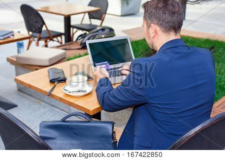 Businessman Working On Laptop, To Pay By Credit Card