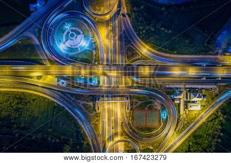 Aerial view Road roundabout with car lots in Thailand.street large beautiful downtown at night.cityscape.Top view.